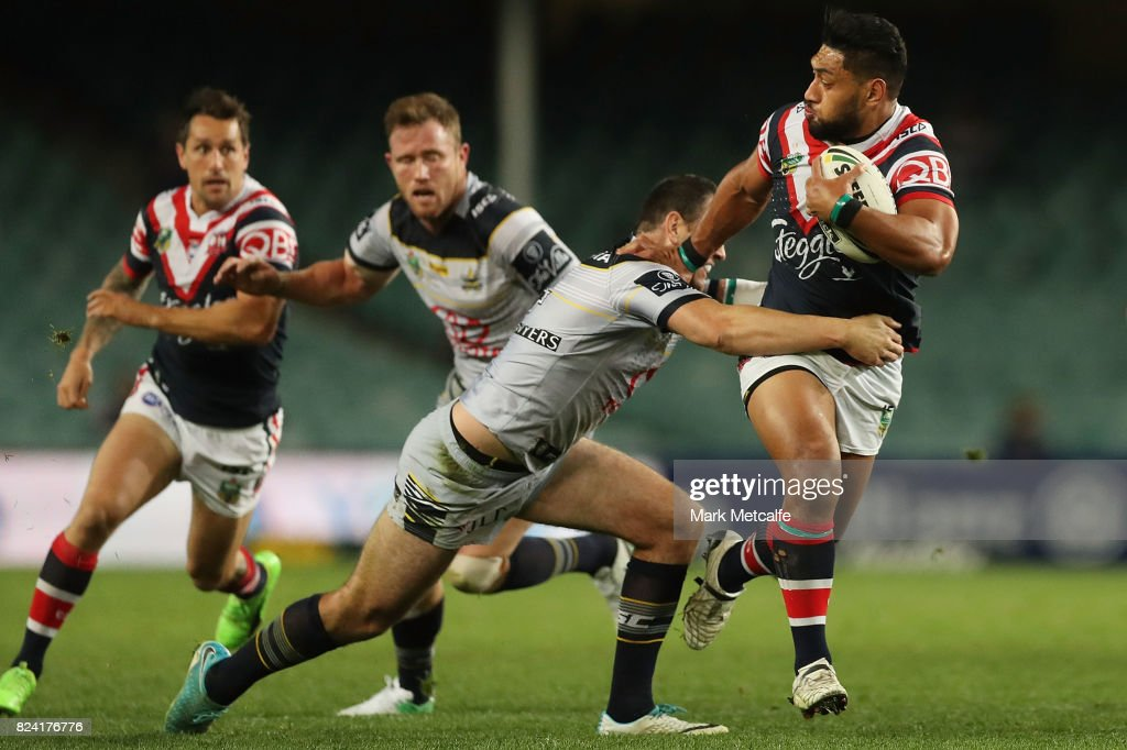 Isaac Liu of the Roosters is tackled during the round 21 NRL match between the Sydney Roosters and the North Queensland Cowboys at Allianz Stadium on July 29, 2017 in Sydney, Australia.
