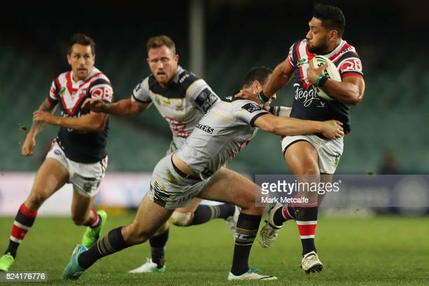 Isaac Liu of the Roosters is tackled during the round 21 NRL match between the Sydney Roosters and the North Queensland Cowboys at Allianz Stadium on...