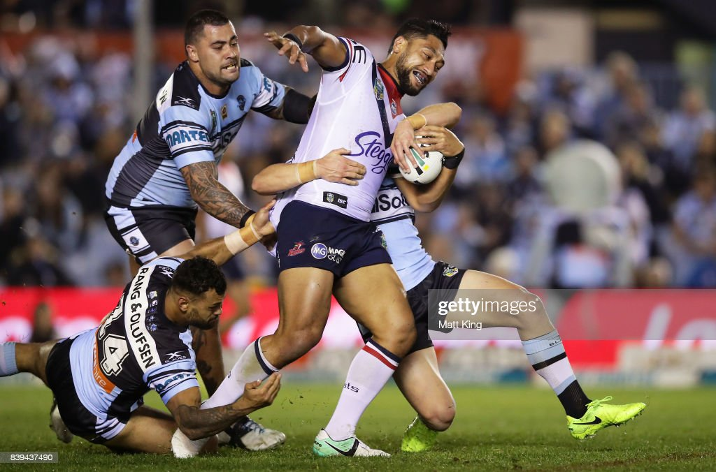 Isaac Liu of the Roosters is tackled during the round 25 NRL match between the Cronulla Sharks and the Sydney Roosters at Southern Cross Group Stadium on August 26, 2017 in Sydney, Australia.