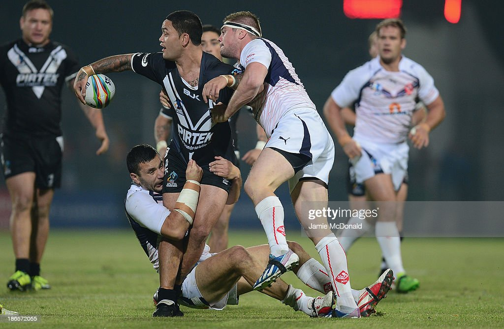Isaac Luke of New Zealand is tackled by Mickael Simon and Vincent Duport of France during the Rugby League World Cup group B match between New Zealand and France at Parc des Sports on November 1, 2013 in Avignon, France.
