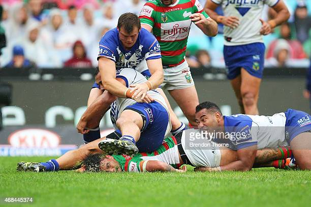 Isaac Luke of the Rabbitohs scores a try after sustaining a knock to the head during the round five NRL match between the Canterbury Bulldogs and the...