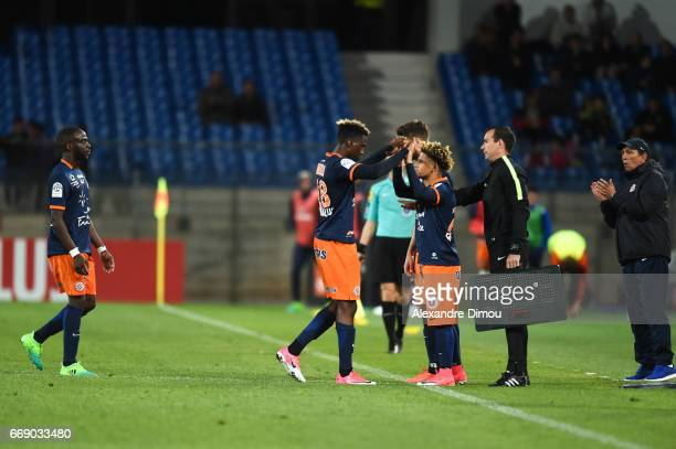 Isaac Mbenza and Keagan Dolly of Montpellier during the Ligue 1 match between Montpellier Herault SC and Fc Lorient at Stade de la Mosson on April 15...