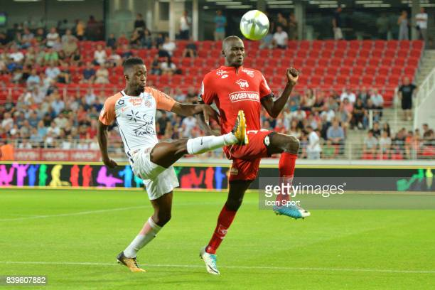 Isaac Mbenza of Montpellier and Cedric YAMBERE of Dijon during the Ligue 1 match between Dijon FCO and Montpellier Herault SC at Stade Gaston Gerard...