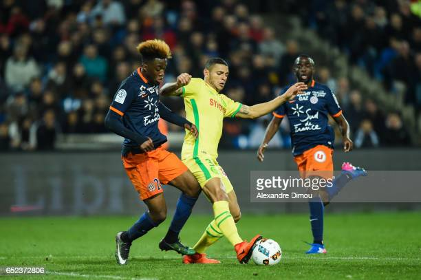 Isaac Mbenza of Montpellier and Diego Santos Silva of Nantes during the Ligue 1 match between Montpellier Herault and Fc Nantes at Stade de la Mosson...