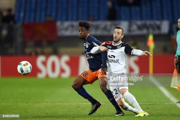 Isaac Mbenza of Montpellier and Jonathan Martins Perreira of Guingamp during the French Ligue 1 match between Montpellier and Guingamp at Stade de la...