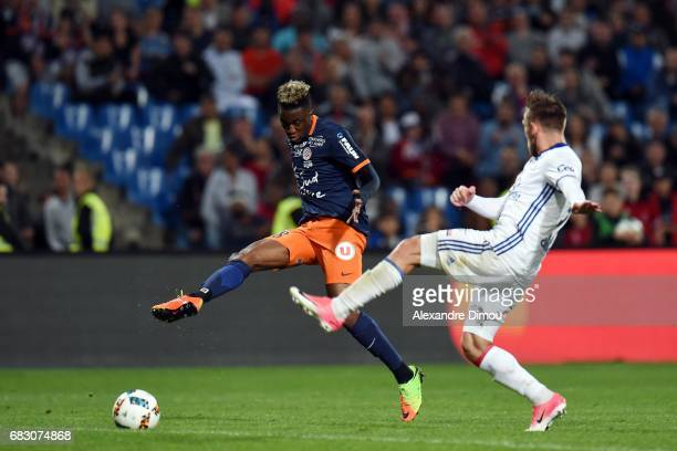 Isaac Mbenza of Montpellier and Maciej Rybus of Lyon during the Ligue 1 match between Montpellier and Olympique Lyonnais Lyon at Stade de la Mosson...
