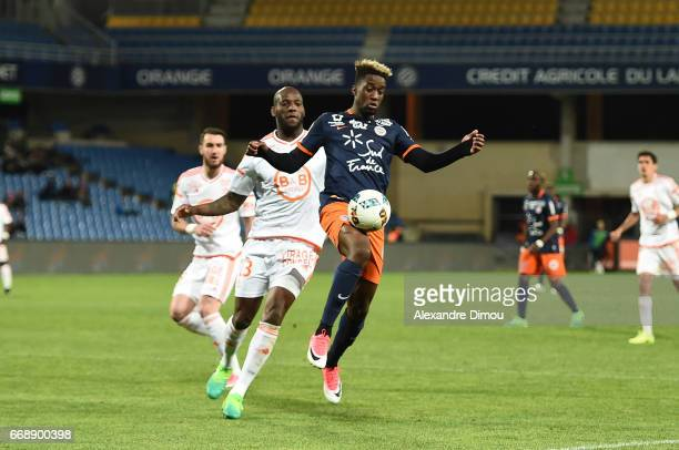 Isaac Mbenza of Montpellier and Michael Ciani of Lorient during the Ligue 1 match between Montpellier Herault SC and Fc Lorient at Stade de la Mosson...