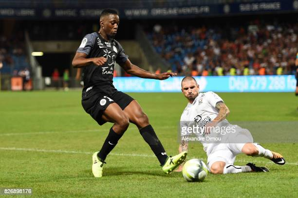 Isaac Mbenza of Montpellier and Vincent Bessat of Caen during the Ligue 1 match between Montpellier Herault SC and SM Caen at Stade de la Mosson on...