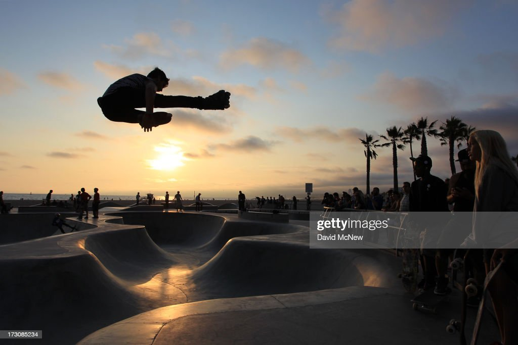 Isaac Mercado makes a jump on rollerblades at sunset on Independence Day weekend at Venice Beach on July 5, 2013 in Venice, California. An estimated 16 million people visit the famous beach city annually which is celebrating 108th birthday as of July 4.