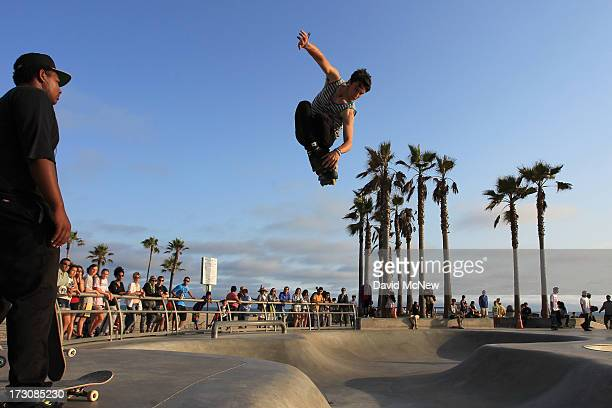 Isaac Mercado makes a jump on rollerblades on Independence Day weekend at Venice Beach on July 5 2013 in Venice California An estimated 16 million...