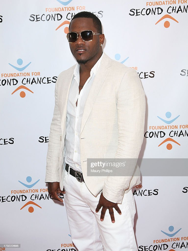 Isaac Newton arrives at Foundation For Second Chances 'Harlem Nights' Casino event at Huntley Hotel on July 9, 2013 in Santa Monica, California.