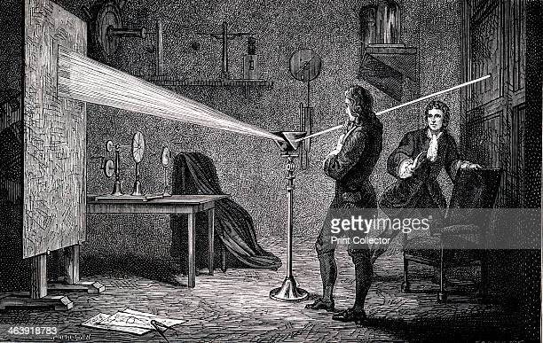 Isaac Newton English scientist and mathematician 1874 Newton using a prism to separate white light into the colours of the spectrum watched by his...