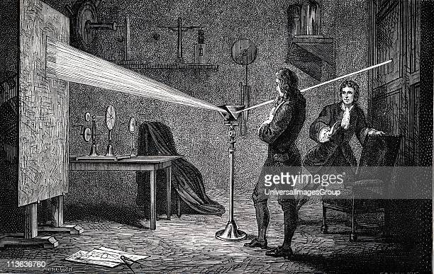 Isaac Newton English scientist and mathematician using a prism to break white light into spectrum With Cambridge room mate John Wickins Engraving of...