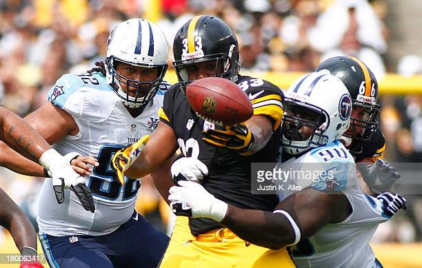 Isaac Redman of the Pittsburgh Steelers fumbles the ball in the first half against the Tennessee Titans during the game on September 8 2013 at Heinz...