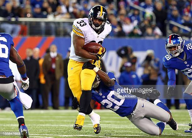 Isaac Redman of the Pittsburgh Steelers in action against Prince Amukamara of the New York Giants at MetLife Stadium on November 4 2012 in East...