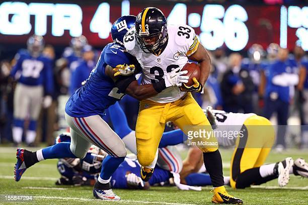 Isaac Redman of the Pittsburgh Steelers in action against Stevie Brown of the New York Giants at MetLife Stadium on November 4 2012 in East...