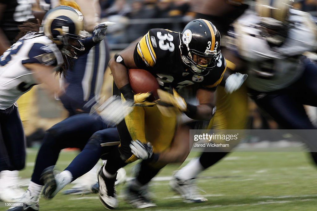Isaac Redman #33 of the Pittsburgh Steelers runs with the ball in the second half against the St. Louis Rams during the Christmas Eve game on December 24, 2011 at Heinz Field in Pittsburgh, Pennsylvania.