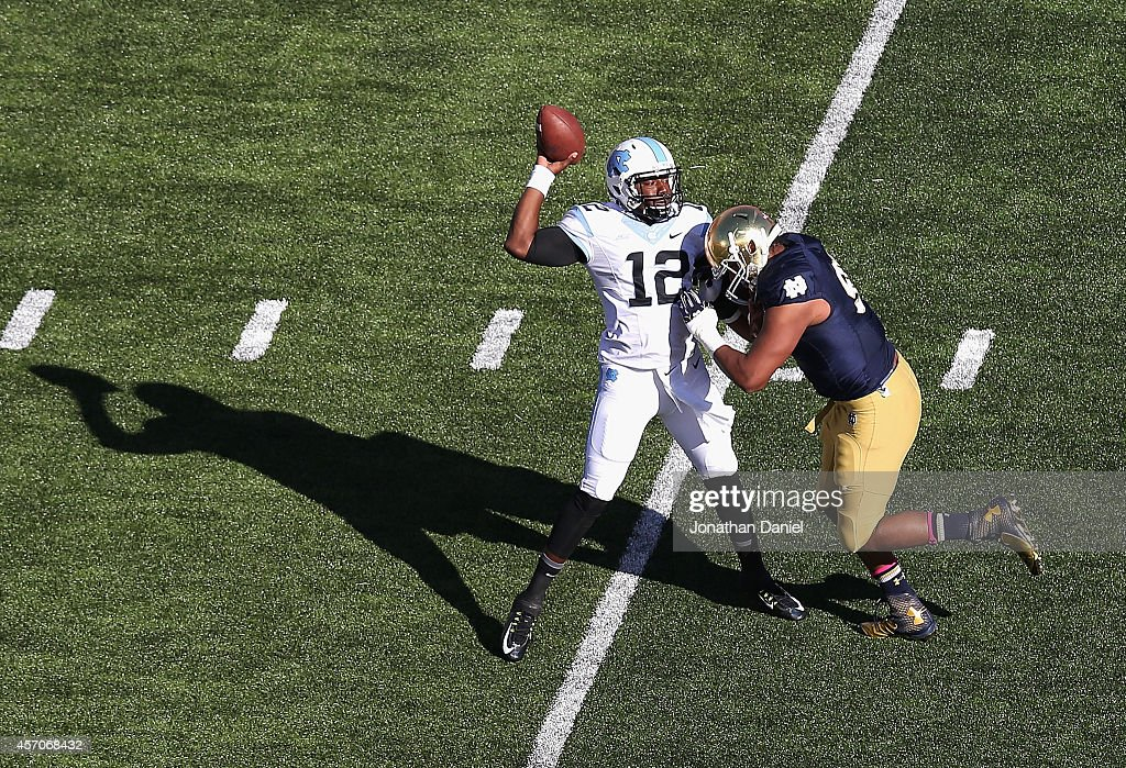 Isaac Rochell of the Notre Dame Fighting Irish pressures Marquise Williams of the North Carolina Tar Heels at Notre Dame Stadium on October 11 2014...