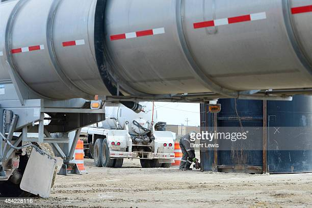 Isaac Shorthair with Triple S Trucking Company fills up a tank with water he just transported from Broomfield August 15 2015 Along with the EPA...