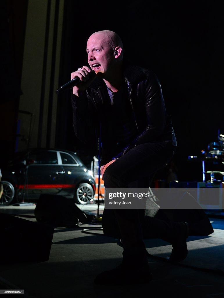 <a gi-track='captionPersonalityLinkClicked' href=/galleries/search?phrase=Isaac+Slade&family=editorial&specificpeople=537604 ng-click='$event.stopPropagation()'>Isaac Slade</a> of the Fray performs in the 7th Annual No Snow Ball concert presented by 97.9 WRMF and Sunny 107.9 at Mizner Park Amphitheatre on December 14, 2013 in Boca Raton, Florida.
