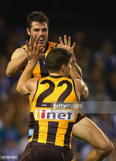 Isaac Smith and Luke Breust of the Hawks celebrate a goal during the round five AFL match between the North Melbourne Kangaroos and the Hawthorn...