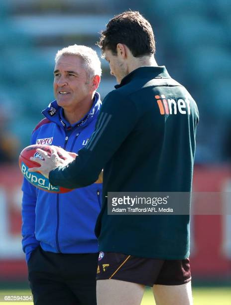Isaac Smith of the Hawks chats to former GM at Hawthorn and current Senior Coach of the Lions Chris Fagan during the 2017 AFL round 08 match between...