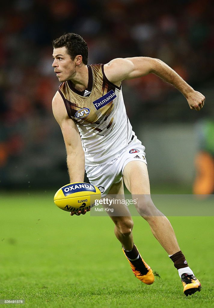 Isaac Smith of the Hawks handballs during the round six AFL match between the Greater Western Sydney Giants and the Hawthorn Hawks at Spotless Stadium on April 30, 2016 in Sydney, Australia.
