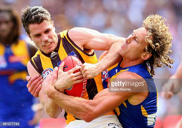 Isaac Smith of the Hawks is tackled by Matt Priddis of the Eagles during the 2015 AFL Grand Final match between the Hawthorn Hawks and the West Coast...