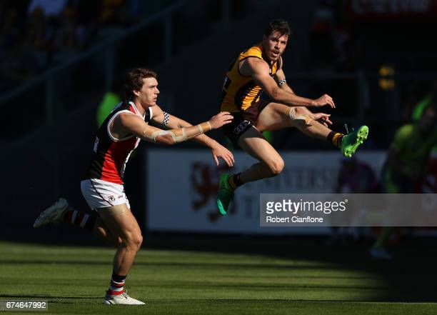 Isaac Smith of the Hawks kicks the ball during the round six AFL match between the Hawthorn Hawks and the St Kilda Saints at University of Tasmania...