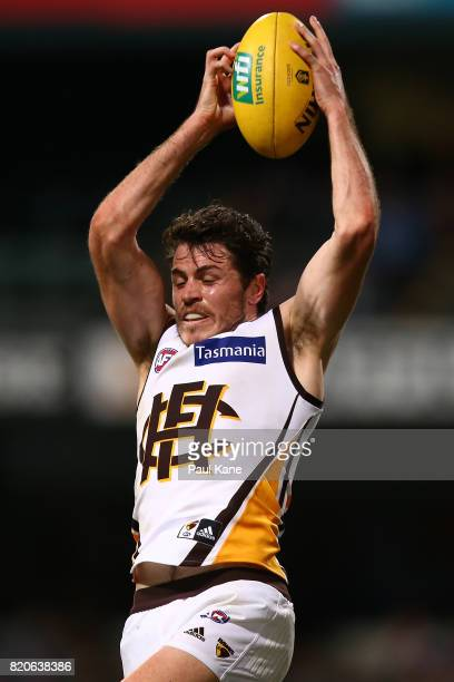 Isaac Smith of the Hawks marks the ball during the round 18 AFL match between the Fremantle Dockers and the Hawthorn Hawks at Domain Stadium on July...