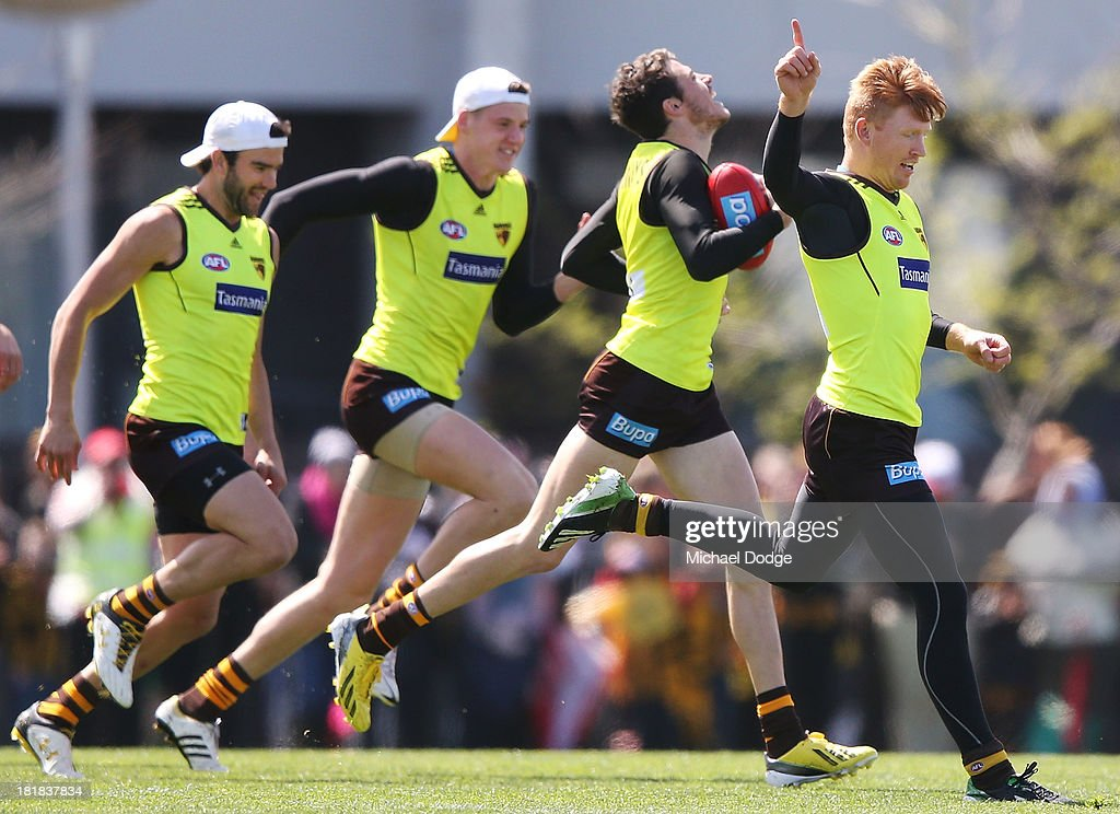 Isaac Smith reacts as Kyle Cheney wins a sprint during a Hawthorn Hawks AFL training session at Waverley Park on September 26, 2013 in Melbourne, Australia.