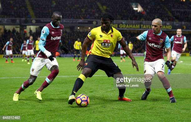 Isaac Success of Watford is closed down by Cheikhou Kouyate of West Ham United and Sofiane Feghouli of West Ham United during the Premier League...