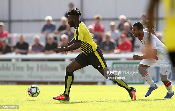 Isaac Success of Watford runs with the ball during the pre season friendly match between Woking and Watford at The Laithwaite Community Stadium on...