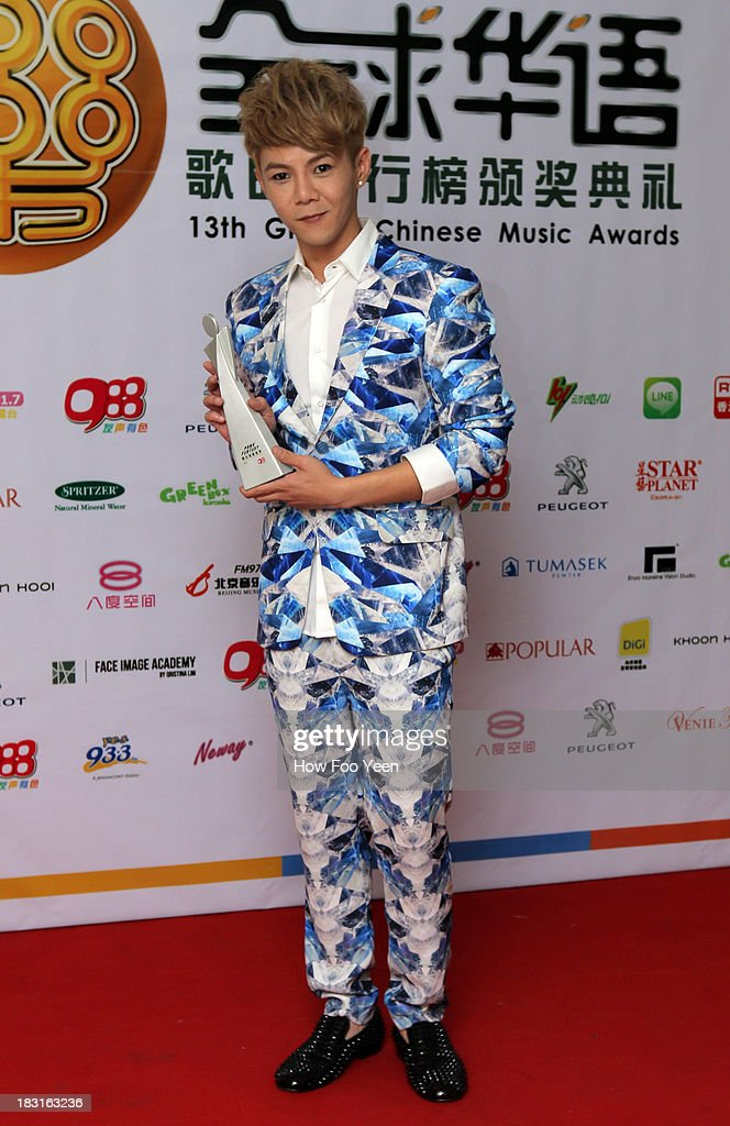 Isaac Teng of Malaysia poses with his Award of the Most Potential New Artiste during the 13th Global Chinese Music Awards at Putra Stadium on October 5, 2013 in Kuala Lumpur, Malaysia.
