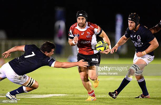 Isaac Thompson of the Vikings breaks through the defence during the NRC match between Queensland Country and UC Vikings at Sunshine Coast Stadium on...
