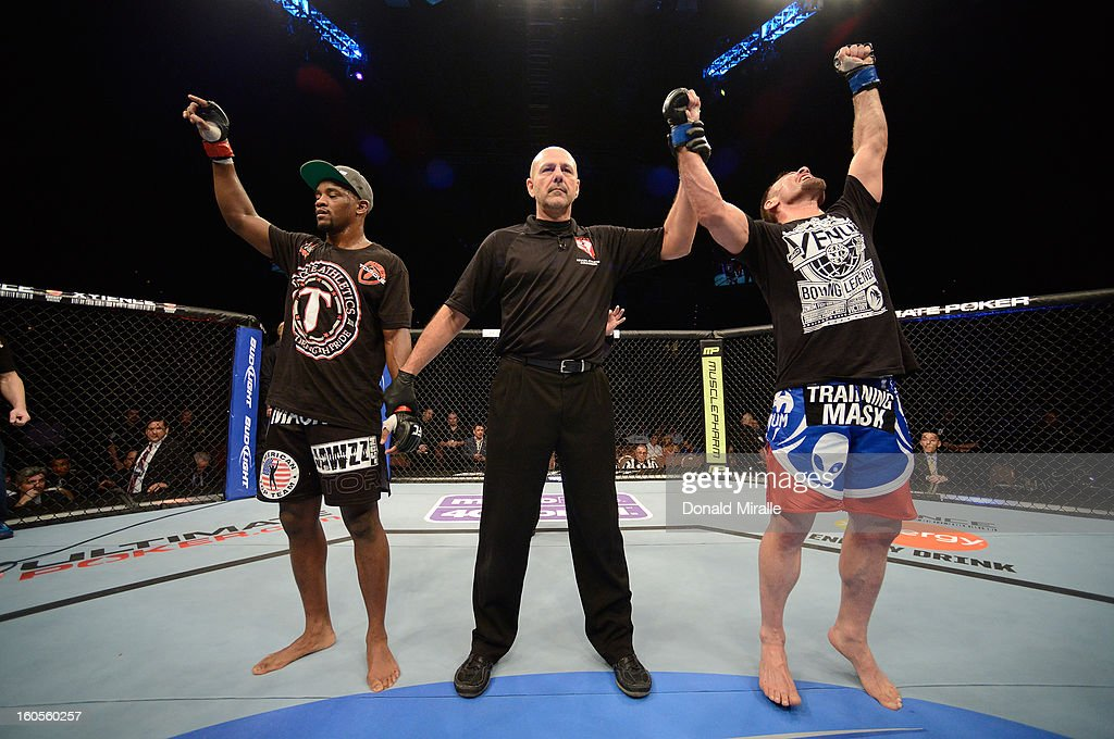 Isaac Vallie-Flagg (right) reacts to his victory over Yves Edwards (left) during their lightweight fight at UFC 156 on February 2, 2013 at the Mandalay Bay Events Center in Las Vegas, Nevada.