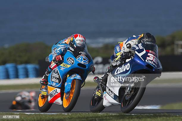 Isaac Vinales of Spain and Calvo Team leads Alex Rins of Spain and Estrella Galicia 00 during free practice for the 2014 MotoGP of Australia at...