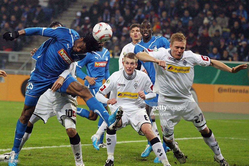 <a gi-track='captionPersonalityLinkClicked' href=/galleries/search?phrase=Isaac+Vorsah&family=editorial&specificpeople=4401187 ng-click='$event.stopPropagation()'>Isaac Vorsah</a> of Hoffenheim tries to score against <a gi-track='captionPersonalityLinkClicked' href=/galleries/search?phrase=Jan-Ingwer+Callsen-Bracker&family=editorial&specificpeople=758385 ng-click='$event.stopPropagation()'>Jan-Ingwer Callsen-Bracker</a> and Jens Wissing (L-R) of M'Gladbach during the DFB Cup round of sixteen match between 1899 Hoffenheim and Borussia M'Gladbach at the Rhein-Neckar Arena on December 21, 2010 in Sinsheim, Germany.