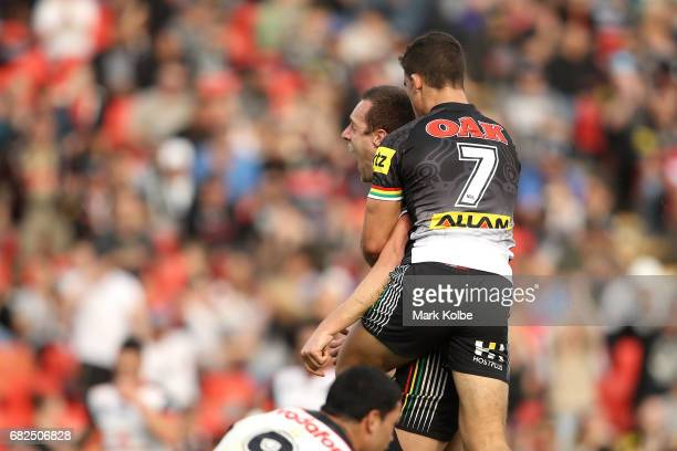 Isaah Yeo and Nathan Cleary of the Panthers celebrate Yeo scoring a try during the round 10 NRL match between the Penrith Panthers and the New...