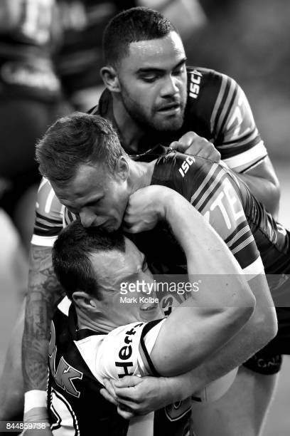 Isaah Yeo of the Panthers is tackled by Daly CherryEvans and Dylan Walker of the Sea Eagles during the NRL Elimination Final match between the Manly...