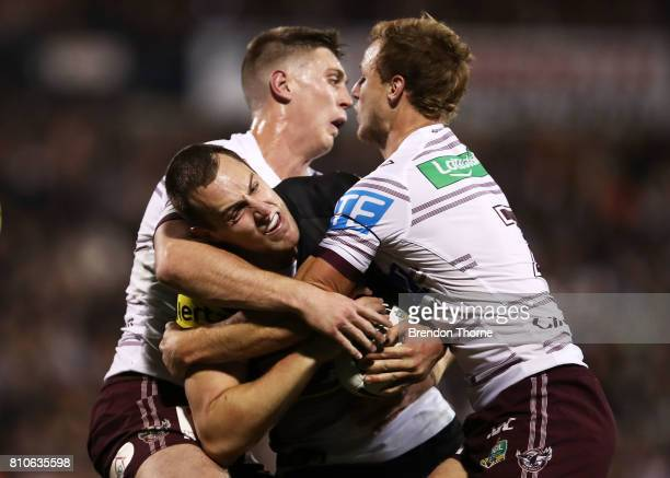 Isaah Yeo of the Panthers is tackled by the Sea Eagles defence during the round 18 NRL match between the Penrith Panthers and the Manly Sea Eagles at...