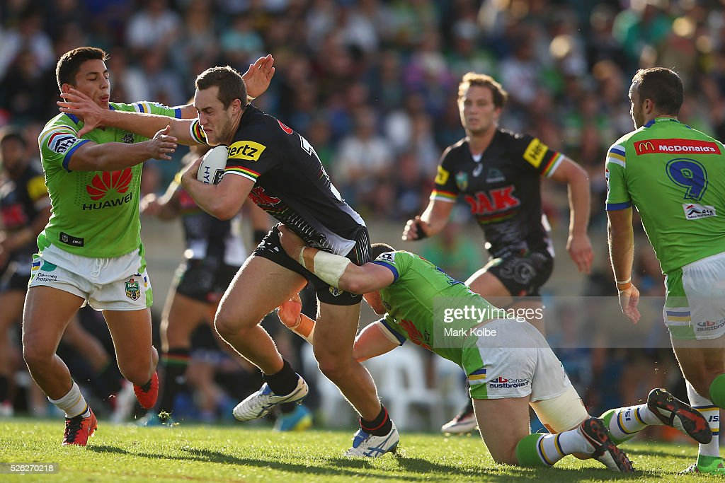 Isaah Yeo of the Panthers is tackled during the round nine NRL match between the Penrith Panthers and the Canberra Raiders at Carrington Park on April 30, 2016 in Bathurst, Australia.