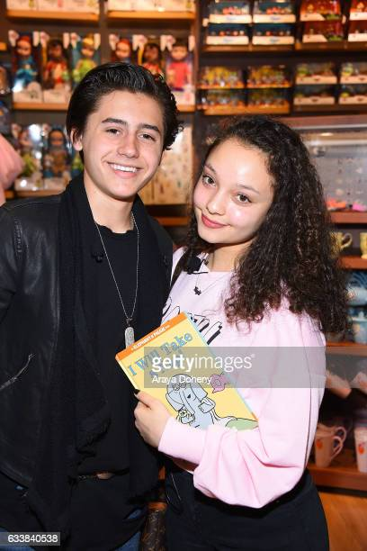 Isaak Presley and Kayla Maisonet attend the Disney Reads Day at the Disney Store on February 4 2017 in Glendale California