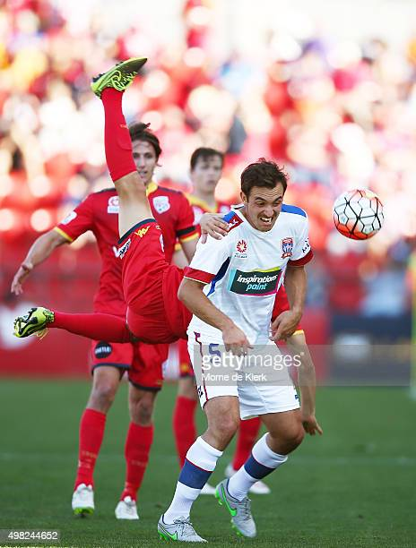 Isaas of Adelaide United comes down behind Ben Kantarovski of Newcastle Jets during the round seven ALeague match between Adelaide United and the...