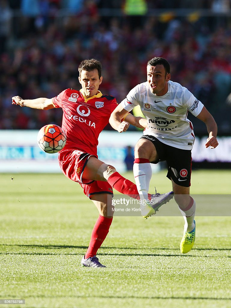 Isaas of Adelaide United competes for the ball with Mark Bridge of the Wanderers during the 2015/16 A-League Grand Final match between Adelaide United and the Western Sydney Wanderers at the Adelaide Oval on May 1, 2016 in Adelaide, Australia.