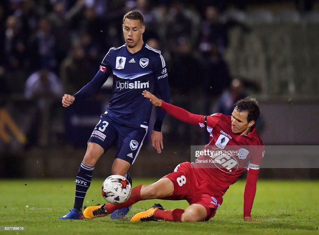 Isaas Sanchez of United tackles Jai Ingham of the Victory during the round of 16 FFA Cup match between Adelaide United and Melbourne Victory at Marden Sports Complex on August 23, 2017 in Adelaide, Australia.