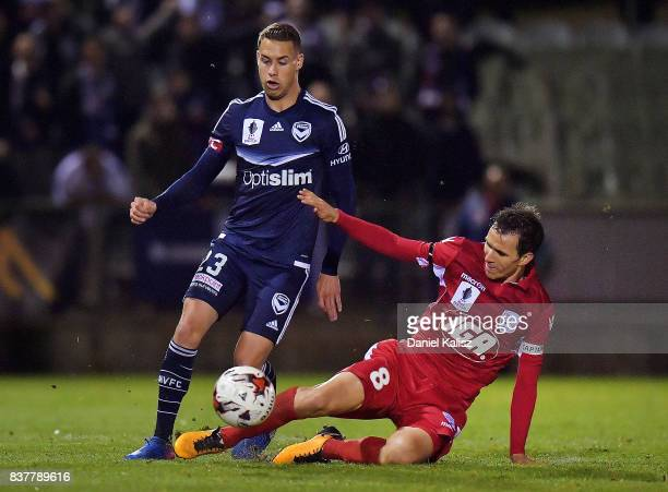 Isaas Sanchez of United tackles Jai Ingham of the Victory during the round of 16 FFA Cup match between Adelaide United and Melbourne Victory at...