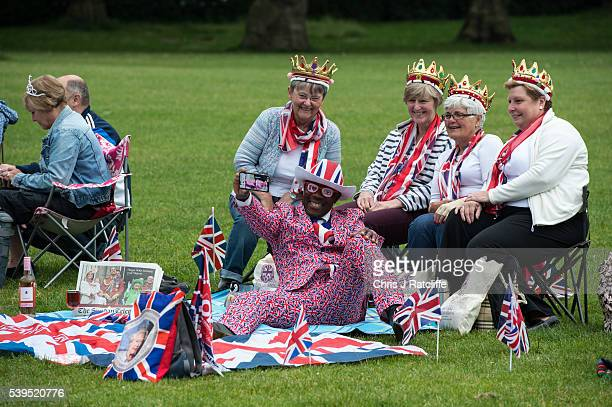 Isabel Bryce Sue Withenshaw Chris Padbury and Eirwen Stevens have a selfie taken with Joseph Afrane in Union Jack clothing as members of the public...