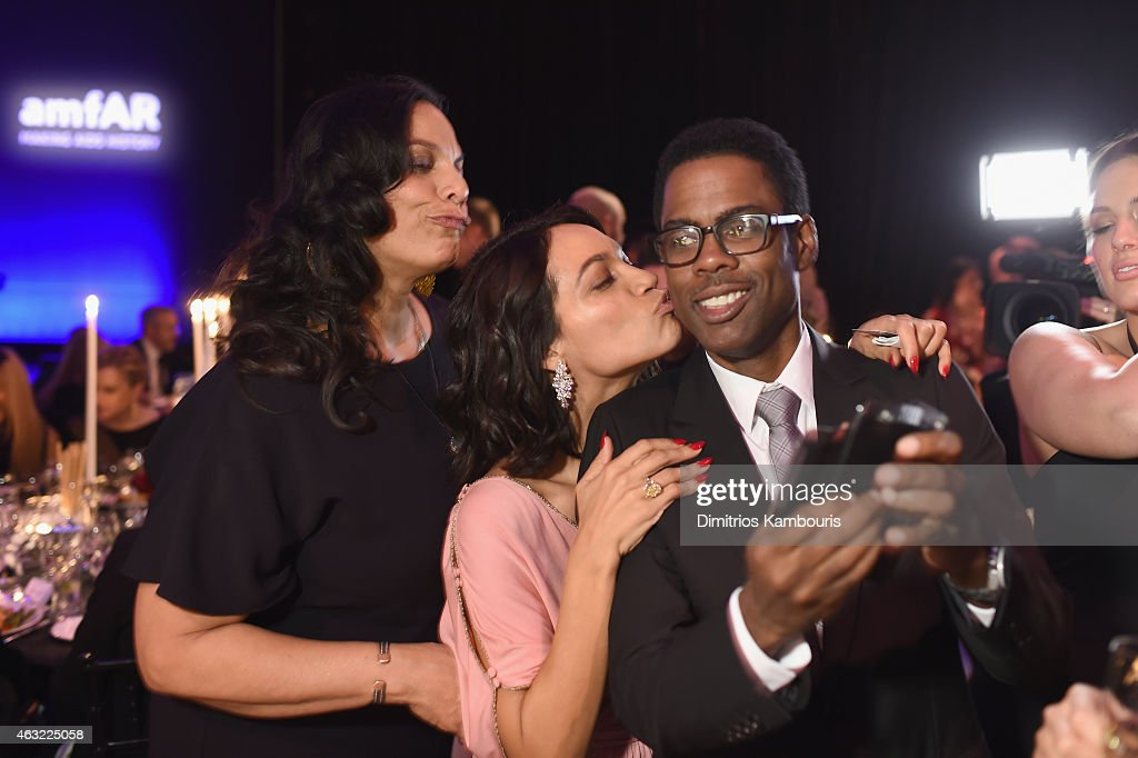 Isabel Celeste, Rosario Dawson and Chris Rock attend the 2015 amfAR New York Gala at Cipriani Wall Street on February 11, 2015 in New York City.