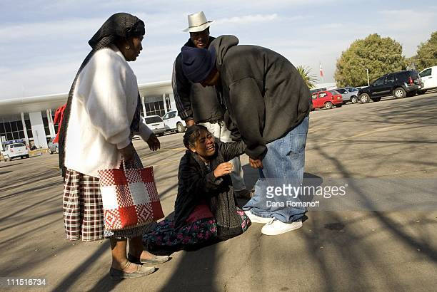 Isabel Cruz Aquino collapses after saying goodbye to her brother at the Oaxaca airport as he boards a plane to Tijuana where he will attempt to cross...